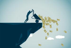 Tip a wheelbarrow full of cash of a cliff